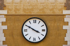 Retro clock on a wall Royalty Free Stock Photos