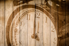 Retro clock on wood background selective focus at number 12 o`clock Stock Photo