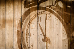 retro clock on wood background selective focus at number 11 o`clock Stock Photos