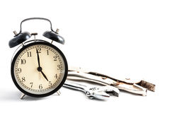 Retro clock and wrench in. Retro clock and wrench in white Stock Images