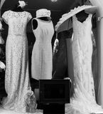 Retro clothes in a shop's window. Wedding dresses and accessories for women in retro style Stock Images