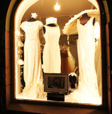 Retro clothes in a shops window. Wedding dresses and accessories for women in retro style Royalty Free Stock Images