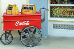 Retro coca cola cart. Vintage coca cola cart with bottles in wooden cases on display at disneyland in hong kong Royalty Free Stock Photography