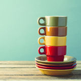 Retro coffee cups. Set on a wooden table royalty free stock photo
