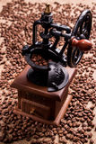 Retro coffee grinder on the background of coffee grains. Stock Photography