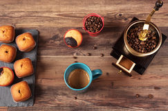 Retro coffee grinder, coffee mill coffee cup, chocolate cupcake, muffins, coffee beans.  Wood backg Royalty Free Stock Images