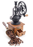 Retro coffee grinder with scoop of coffee beans Royalty Free Stock Images