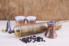 Retro coffee grinder and a Turkish coffee set Stock Photo