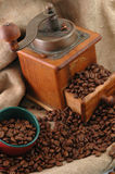 Retro coffee grinderwith cup Stock Photography