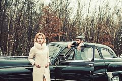 Retro collection car and auto repair by mechanic driver. Couple in love on romantic date. Bearded man and sexy woman in. Retro collection car and auto repair by royalty free stock photo