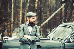 Retro collection car and auto repair by mechanic driver. Travel and business trip or hitch hiking. Bearded man in car stock photos