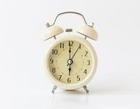 Retro color alarm clock on white background Royalty Free Stock Photos