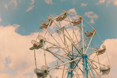 Dreamy Ferris Wheel at a Carnival. A Retro Color Scheme for a Dreamy Ferris Wheel at a Carnival Royalty Free Stock Photography