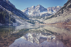 Retro color toned Maroon Bells mountain lake landscape, USA. Stock Photo