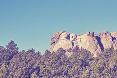 Retro color toned Mount Rushmore National Memorial, USA. Royalty Free Stock Photos