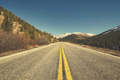 Retro color toned scenic mountain road, Colorado, USA. Royalty Free Stock Photos