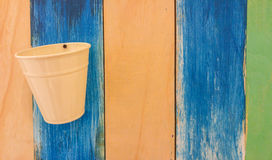 Retro Color Wood Texture Background with Empty Beige Can  Stock Photos