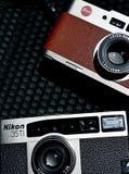 Retro compact Leica CM and Nikon 35Ti camera. Classic compact Leica CM brown , and retro . Vintage cameras Nikon 35Ti, with 35mm film technology never die stock photos