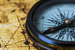 Retro compass on antique world map Stock Image