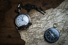 Retro compass and vintage map Stock Photography