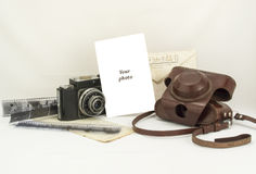 Retro composition of old camera, films, letter, envelope Stock Photos