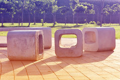 Retro concrete seats, retro vintage look. Retro concrete seats in a city park Royalty Free Stock Photos