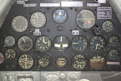 Retro control panel in war plane cockpit Stock Images
