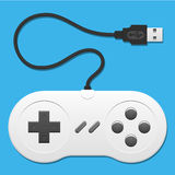 Retro controller with usb cable. Blue background stock illustration