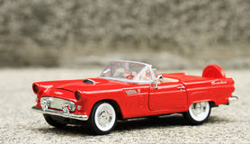Retro convertible toy car. On a cement pavement Royalty Free Stock Image