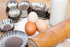 Retro cookie cutters and ingredients for baking dough Royalty Free Stock Image