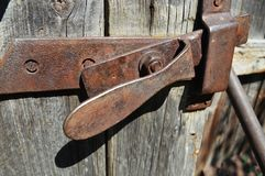 Retro copper door bolt. Horizontal close up photo with old wooden door. stock photo