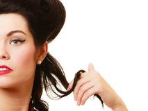 Retro. Coquette pinup girl playing with hair Stock Photos