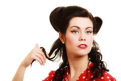 Retro. Coquette pinup girl playing with hair Royalty Free Stock Photo