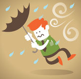 Retro Corporate Guy blown away with Umbrella. Royalty Free Stock Photo