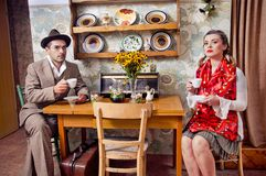 Retro couple. Drinking coffee or tea Stock Image