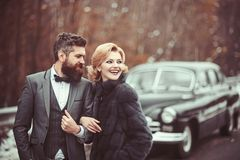 Retro couple against old car. couple in love. stock images