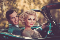 Happy couple in a car Stock Images