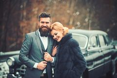 Retro couple at vintage car travelling in winter royalty free stock photos