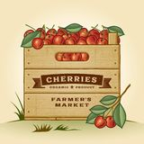 Retro crate of cherries. Retro wooden crate of cherries in woodcut style. Editable EPS10 vector illustration with clipping mask and transparency Royalty Free Stock Images