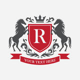 Retro crest with red shield and two horses Royalty Free Stock Photos