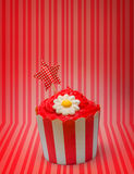 Retro cupcake with star and flower icing Royalty Free Stock Photos