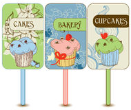 Retro cupcakes labels. Vertical cupcakes banners in bright colors Royalty Free Stock Images