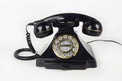 Retro Czarny telefon Odizolowywający zdjęcia stock