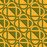 Retro 3D green and orange diagonally cut intersecting ovals Royalty Free Stock Image