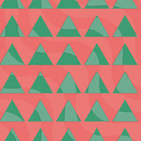 Retro 3D green triangles on red. Abstract layered pattern. Bright colored background with realistic shadow and thee dimensional effect Royalty Free Stock Photo