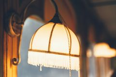 Retro decoration lamp. Closeup vintage or retro decoration lamp in the restaurant stock image