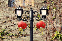 Retro decorative road lamp, vintage street lamp, old street light with Chinese lanterns Royalty Free Stock Photography