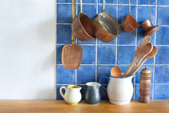 Retro design kitchen interior with accessories. Hanging copper kitchenware set. Day light Stock Photography