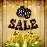 Retro design poster for big sale with gift boxes, balls, and pine tree on wood background. Illustration of Retro design poster for big sale with gift boxes Stock Image
