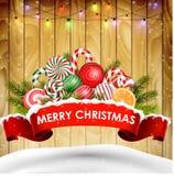 Retro- Designplakathintergrund für Weihnachten mit Süßigkeit, realistischem Band und Kiefer auf hölzernem Stockfotografie